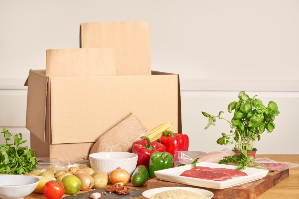 A subscription box meal kit being unpacked