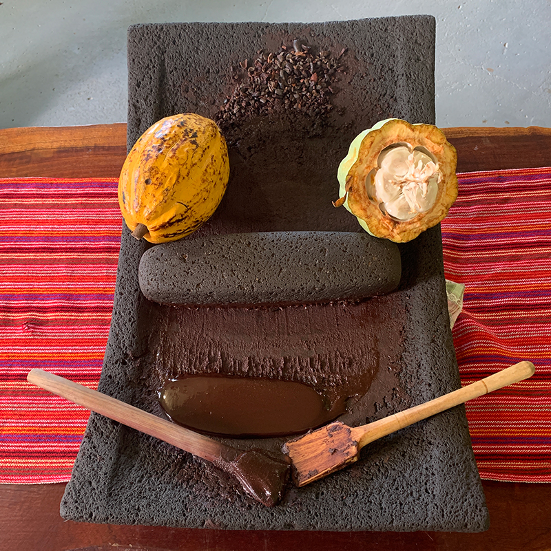 stone used to grind cocoa beans into edible chocolate